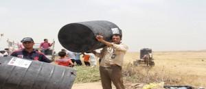 توزيع خزانات مياة لصالح المزارعين شمال قطاع غزة